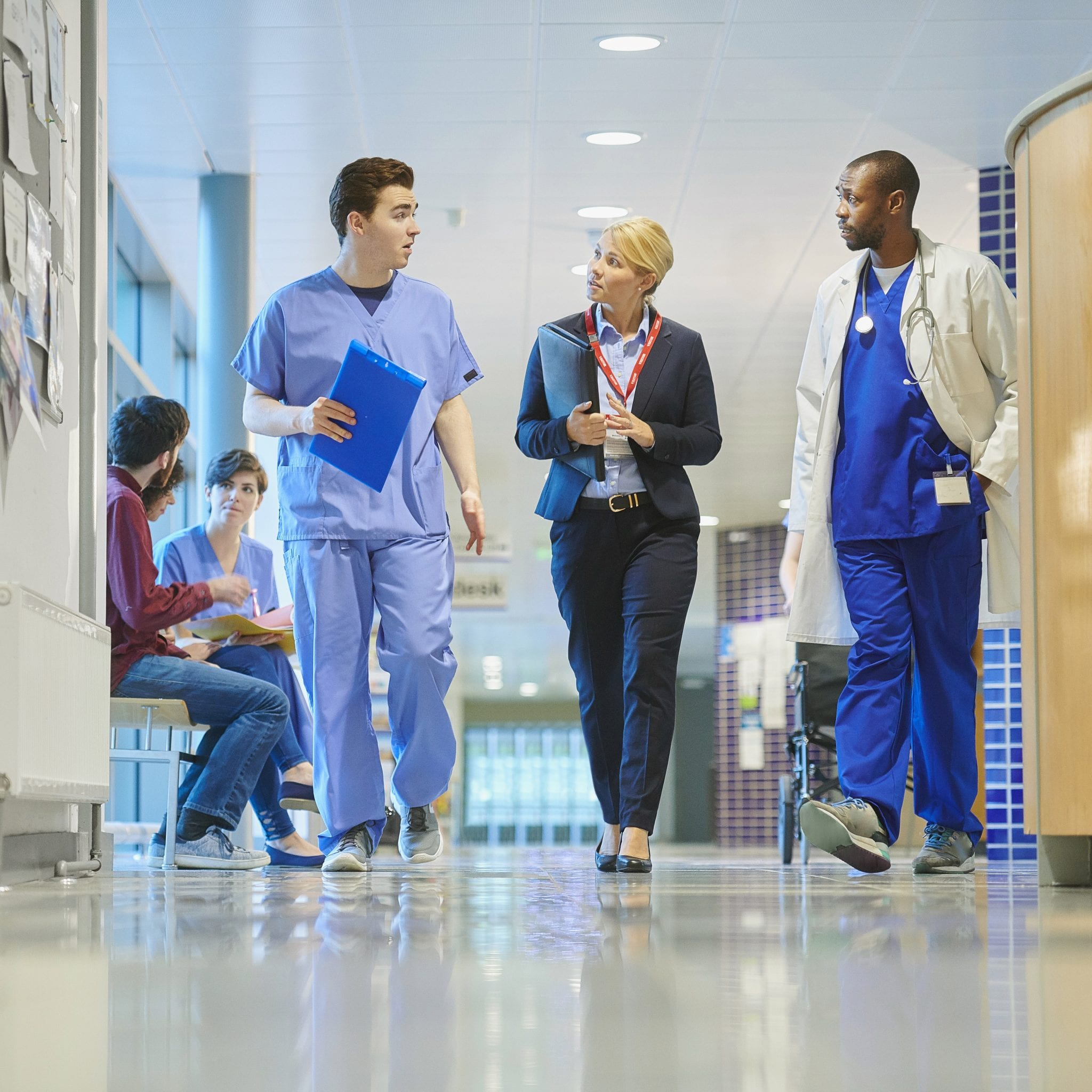 Medical Legal Professionals walking down a hallway